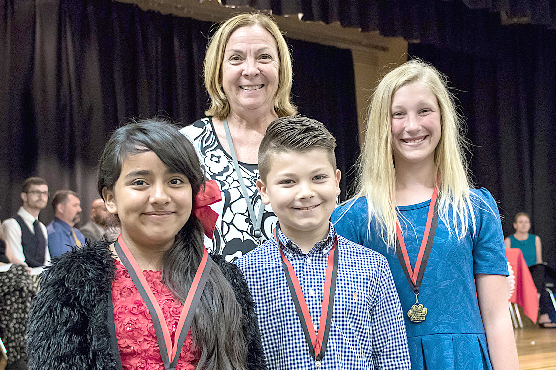 SOCIAL STUDIES AWARDS were given to Melissa Molina Ramirez, Carter Haun and Evan Lipscomb during the Fifth Grade Awards at George R. Stuart Elementary. They are joined by Nancy Cooke.