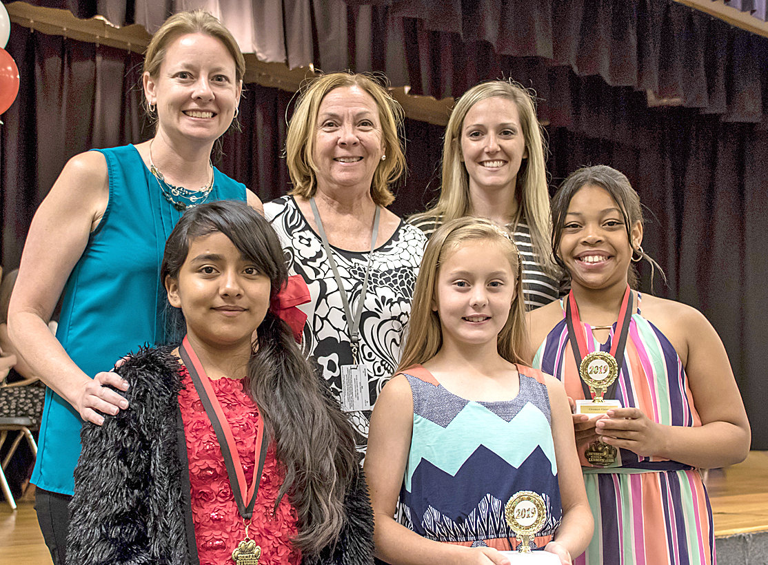 GREATEST GAINS AWARDS were given to three fifth-graders at George R. Stuart Elementary. From left, front,  are Melissa Molinas Ramirez, Madison Thomas and Nanielle Walker. In back are  Christina Melton, Nancy Cooke and Megan Martin.