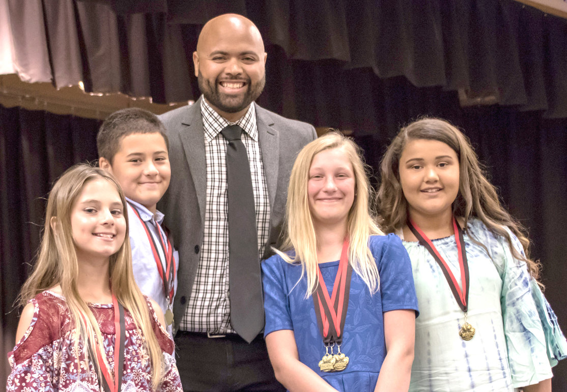 MUSIC AWARDS were presented by Jay Garcia to students Rylan Ledford, Aiden Diaz, Eva Lipscomb and Shae-Lee Thomas during George R. Stuart Elementary's Fifth Grade Awards.