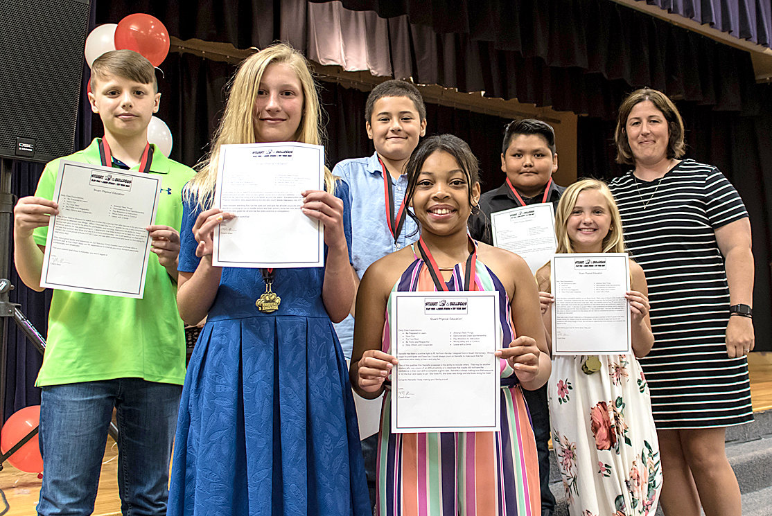 PE AWARDS were given to George R. Stuart Elementary fifth-graders Silas Giannasio, Eva Lipscomb, Aiden Diaz, Nanielle Walker, Eduardo Ramirez-Ortiz and Macy Butler by Mindy Kiser.
