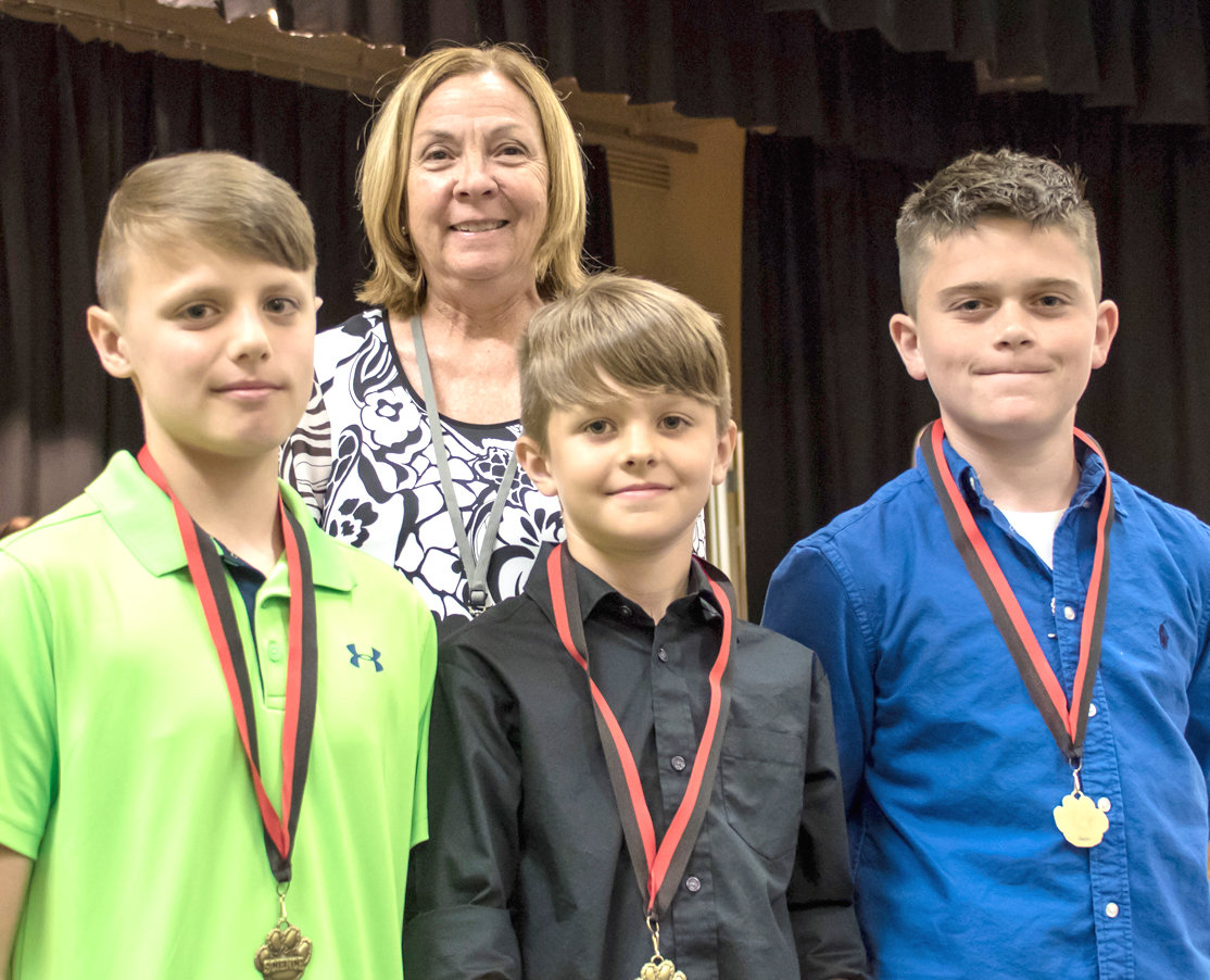 SCIENCE AWARDS were given to George R. Stuart Elementary fifth-graders Silas Giannasio, James Eledge and Dominic Renzulli by Nancy Cooke during a recent award ceremony.