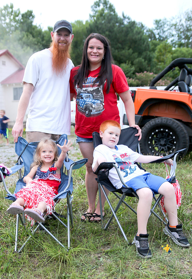 THE MCKINNEY FAMILY SQUEEZES in one last photo before the fireworks celebration at FleaLand FleaMarket on Thursday. Pictured from left front are Ellie McKinney and Conner McKinney. Pictured from left rear are Cody and Krissy McKinney.