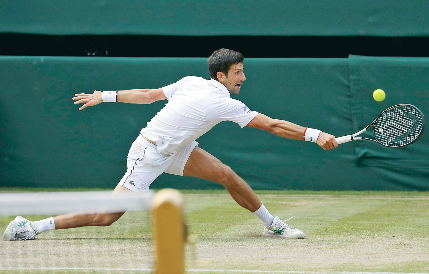 Serbia's Novak Djokovic returns the ball to Switzerland's Roger Federer during the men's singles final match of the Wimbledon Tennis Championships in London, Sunday.