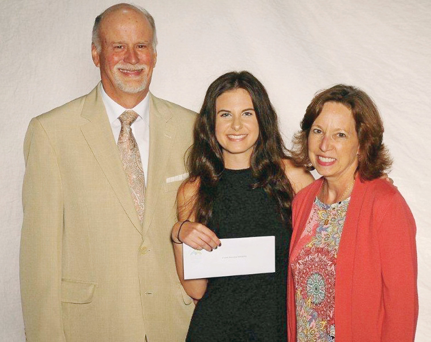 KRISTA RIAD, center, a 2019 graduate of Cleveland High School, has been named recipient of the inaugural Coombs Motivation Scholarship. Making the scholarship presentation are founders Dr. Rob Coombs, left, and Dr. Janet Coombs, right.