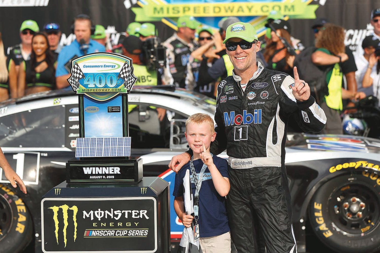 KEVIN HARVICK celebrates with his son, Keelan, after winning Sunday's NASCAR race at Michigan International Speedway in Brooklyn, Mich.