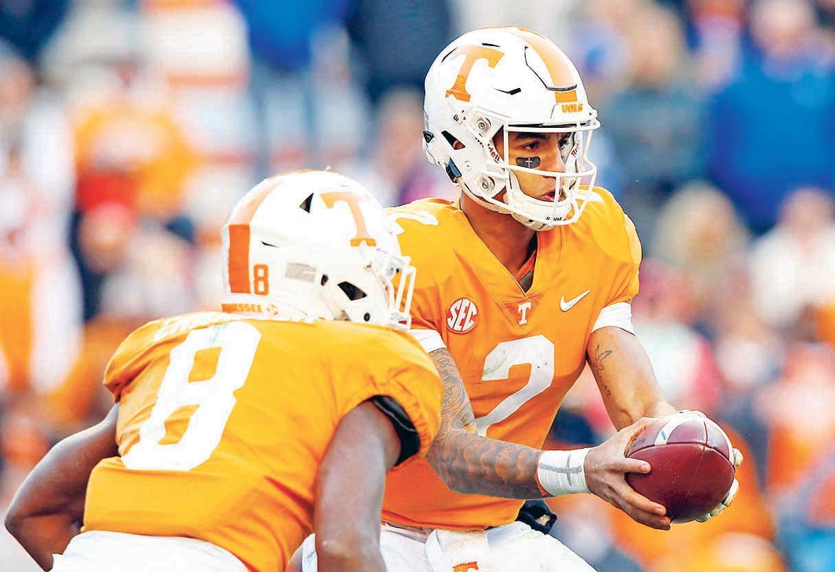 TENNESSEE QUARTERBACK Jarrett Guarantano (2) hands the ball off to running back Ty Chandler (8) against Kentucky in Knoxville, in this 2018 photo. Tennessee is hoping to improve after going 5-7 in 2018 while posting a second straight last-place finish in the SEC East.