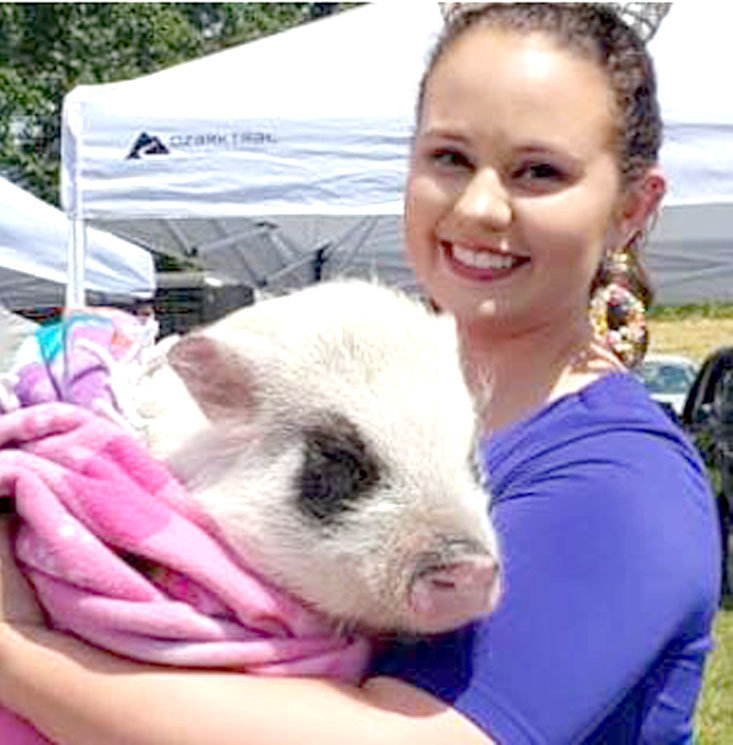 Brittany Krouse Graves, recently names Mrs. America Agriculture, poses with her pet pig Calypso. Graves is passionate about pigs and their intelligence as both house pets and therapy animals, something she discussed in the platform she used the achieve her new national title.