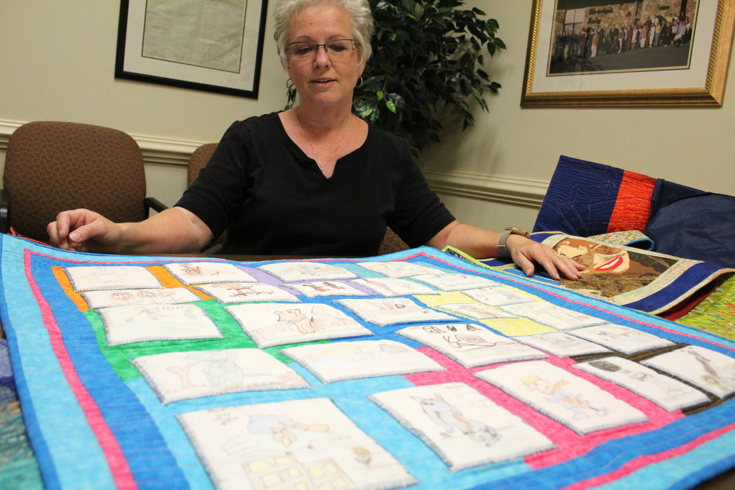 "CHARLESTON-BASED QUILTER Sandra Presley shows off her work titled, ""Taylor's Pappyland Artwork"" during an interview with the Cleveland Daily Banner."