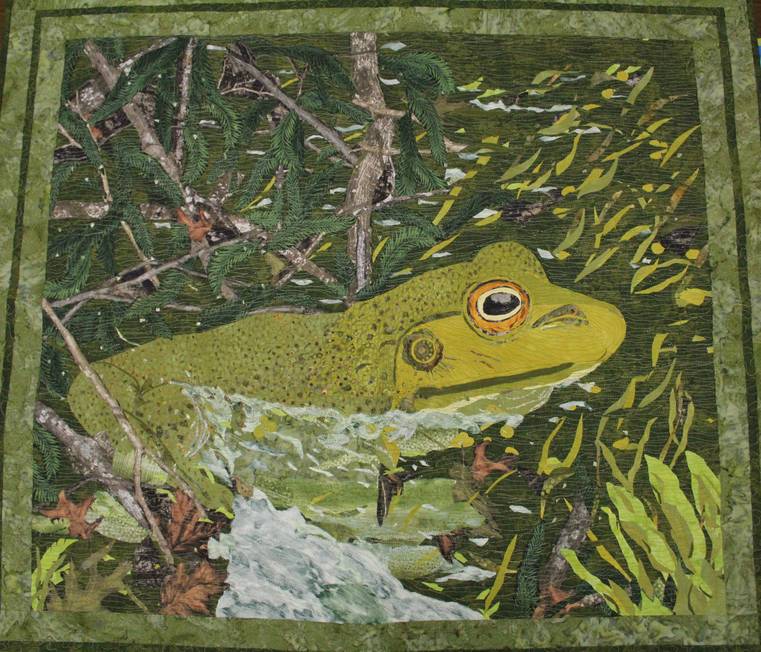 """FROGGY BOG"" is the second quilt in a series of photography-inspired works by Sandra Presley, of Charleston. She said each quilt takes her weeks and features scraps of fabric as small as a single pea to create dimension and depth."