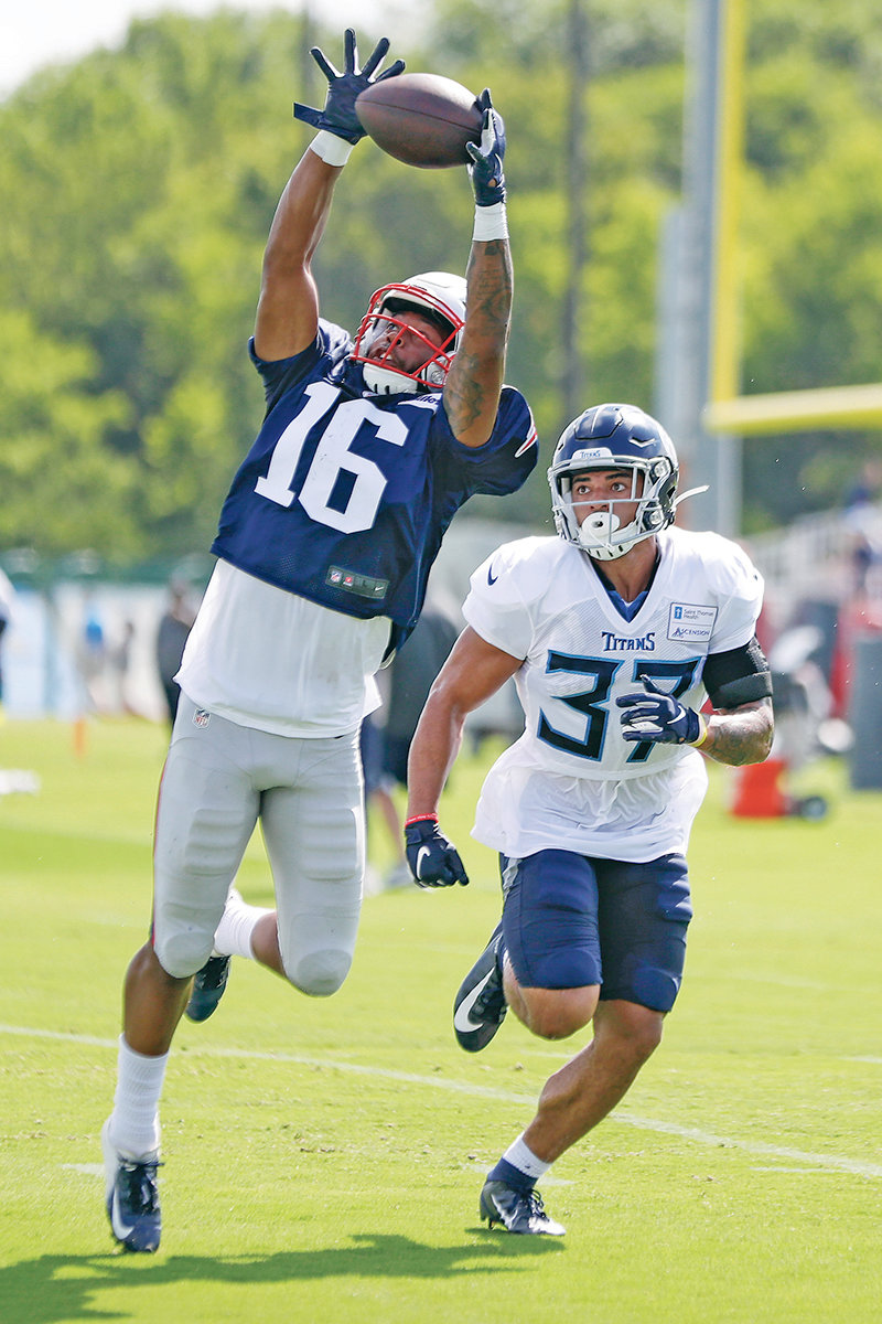 PATRIOTS wide receiver Jakobi Meyers (16) reaches for a pass as he is defended by Tennessee Titans defensive back Amani Hooker (37) Wednesday, in Nashville.
