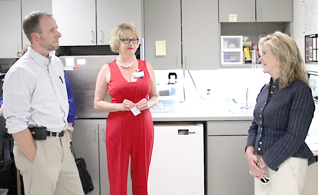 U.S. SEN. MARSHA BLACKBURN, R-Tennessee, right, speaks with The Surgery Center of Cleveland's Administrator Marietha Silvers and Dr. G. Seth Ford, M.D., during a tour of the facility on Wednesday. Ford is a Cleveland-area ophthalmologist.