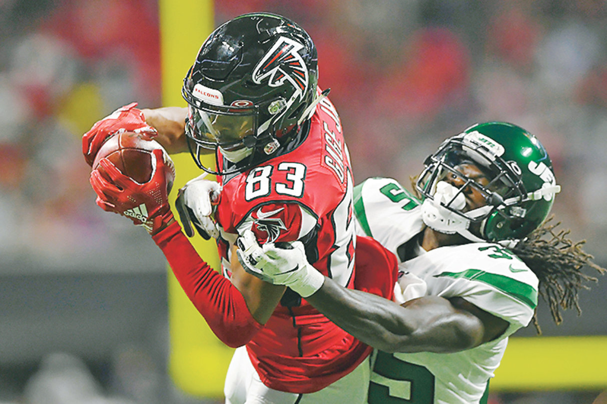 NEW YORK JETS defensive back Tevaughn Campbell (35) tackles Atlanta Falcons wide receiver Russell Gage (83) in the first half Thursday, in Atlanta.
