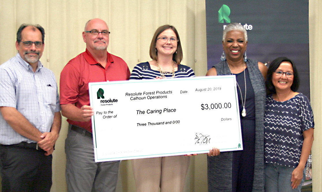 THE CARING PLACE was awarded a $3,000 donation by Resolute Forest Products. From left are  Resolute EMS director Robert Sherwood, Resolute General Manager Scott Palmer, The Caring Place executive director Corinne Freeman, The Caring Place board member Toni Miles and Resolute staffer Bella Ngo.