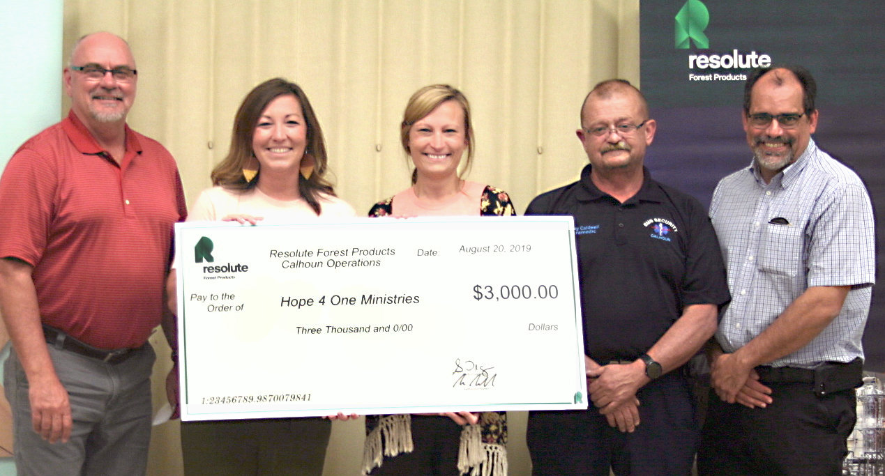 HOPE 4 ONE MINISTRIES received a $3,000 donation from Resolute Forest Products. From left are Resolute General Manager Scott Palmer, Hope 4 One founders Lauren Haun and Camill Howard, Resolute worker Danny Caldwell and Resolute EMS director Robert Sherwood.