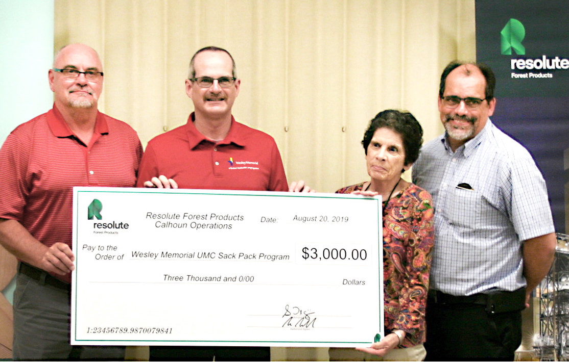 WESLEY MEMORIAL United Methodist Church's Sack Pack program received a $3,000 donation from Resolute Forest Products. From left are Resolute General Manager Scott Palmer, Wesley Memorial pastor Ramon Torres and Sack Pack director Diana Whittle, and Resolute EMS director Robert Sherwood.