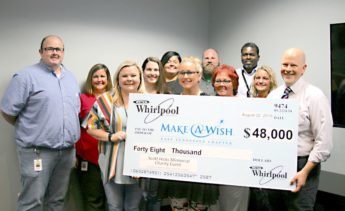 FROM LEFT Whirlpool employees Jeremy Monger, Brandi King, Lacy Bain, Brittany Broadhead, Shannon Russo, Kia Taylor, Patton Musick, Lisa Sexton, Christa Rants and Nahum Faubert Paulin, and East Tennessee Make-A-Wish CEO Garrett Wagley hold a check for $48,000 donated by Whirlpool from their annual fundraiser.