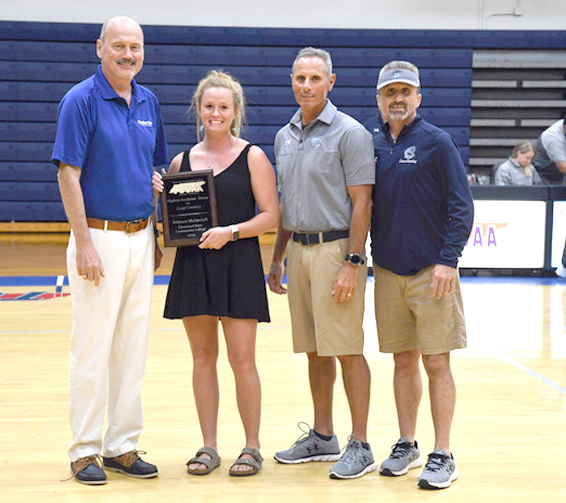 FORMER CLEVELAND STATE cross country standout Whitney McConnell, second from left, earned the TCCAA's Highest Academic Honor and congratulated by, from left, CSCC President Dr. Bill Seymour, Athletic Director Mike Policastro, and Head Cross Country Coach David Kyle before Thursday's season-opening volleyball match.