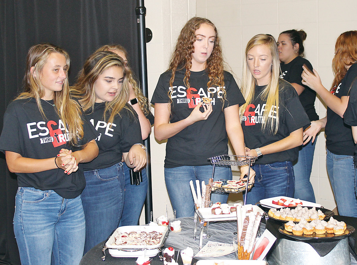 BRADLEY CENTRAL High School students were enjoying the dessert treats provided by sponsoring vendors at Saturday evening's Trek Thru Truth Gala. The students also helped clean up following the meal, and assisted with an Escape Room exercise during the program. The exercise was an example of interactive exhibits to be placed at Bradley Square Mall.