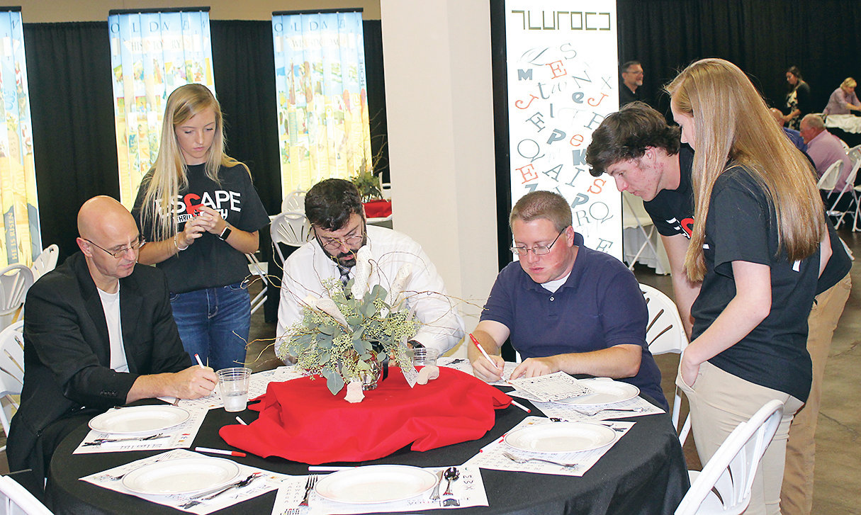 THREE BRADLEY CENTRAL High School students, standing, were assisting attendees at Saturday evening's Trek Thru Truth Gala during an Escape Room exercise Saturday. The exercise was provided for supporters of the proposed Biblical children's museum as an example of interactive exhibits which will be placed in leased space at Bradley Square Mall, and in the museum once it is constructed on a 58-acre site near Highway 64 east of Cleveland. The museum will eventually feature 52 educational exhibits.