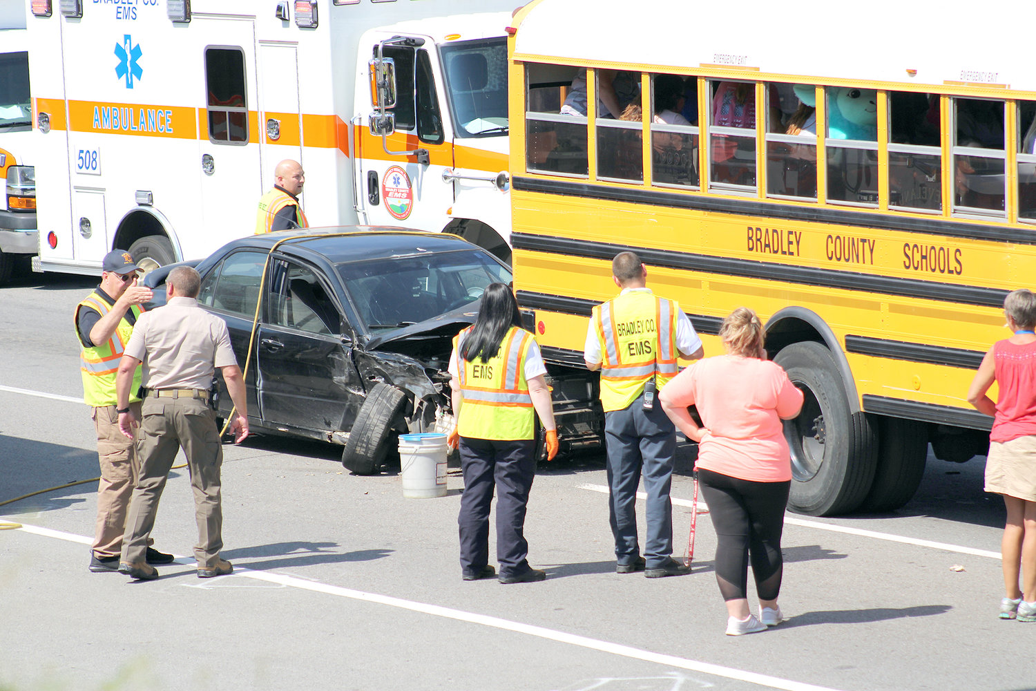 A VEHICLE is partially wedged underneath a Bradley County Schools activity bus after it slammed into the bus Monday afternoon on Georgetown Road N.W., near Exit 25. No students were injured in the accident. The driver was transported to a local hospital, where he was treated for minor injuries.