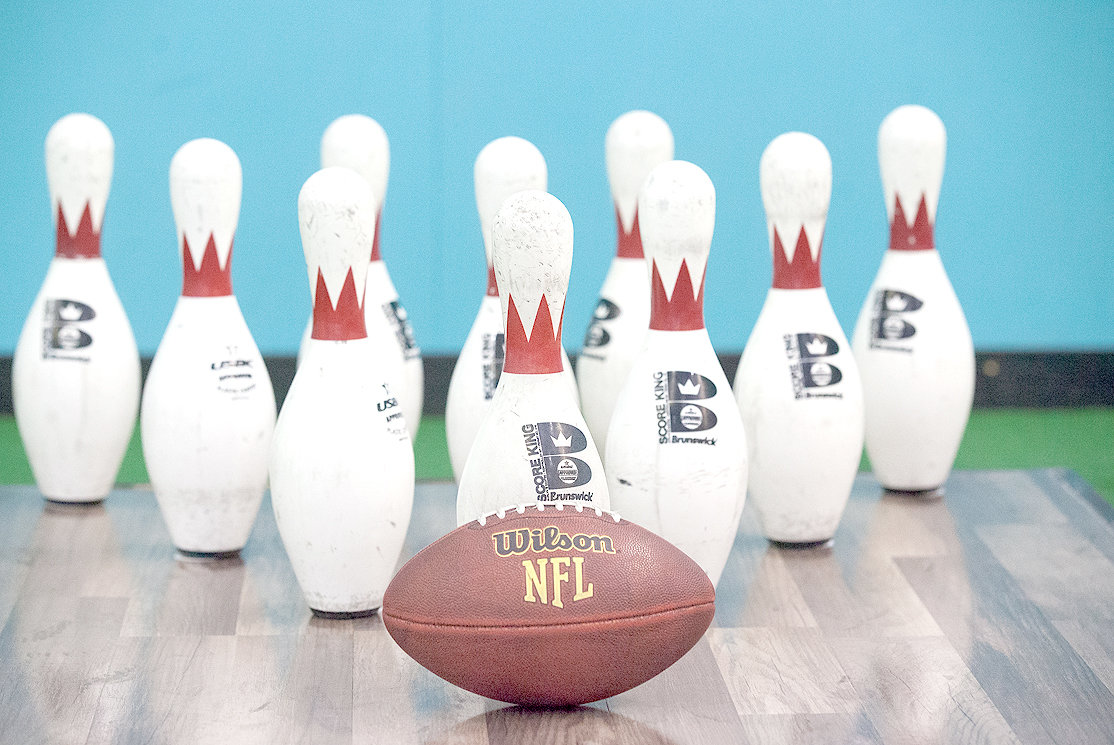 FOOTBOWLING, the wacky combo sport, is set up at Axetreme Arena in Bradley Square Mall. The sport substitutes the rolling of a bowling ball for the toss of a football at bowling pins.