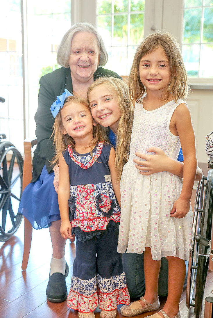 LIFE CARE RESIDENT Jane Hetzel, behind left, poses for a photo with her great-granddaughters before the judging of the Mr. and Ms. Life Care event. From left are Hetzel, Laney Kate Weaver, Kaiya Laney and Raelyn Weaver.