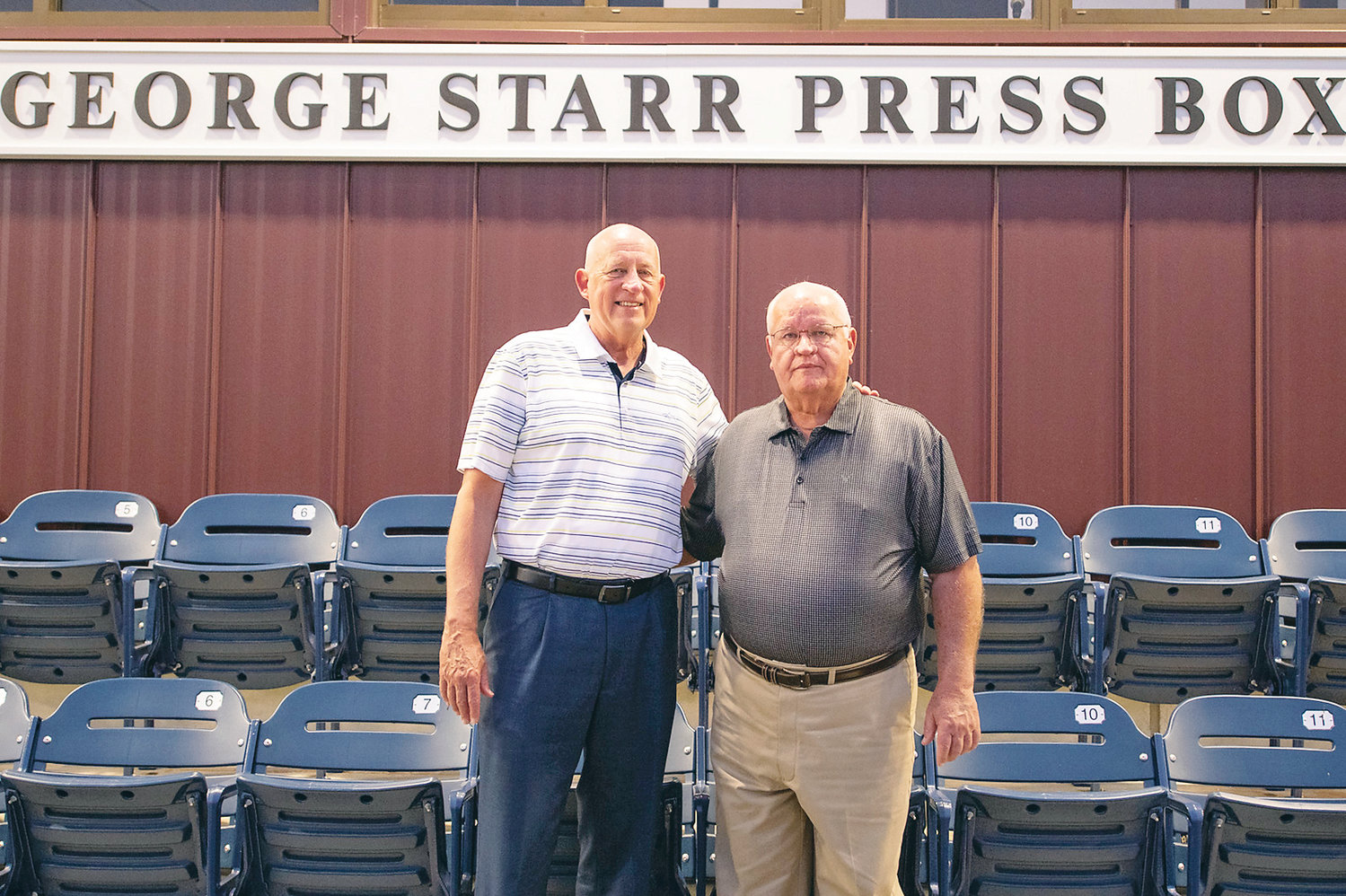 LEE ATHLETICS DIRECTOR Larry Carpenter, left, and the Voice of the Flames, George Starr, were honored at Olympic Stadium last week.