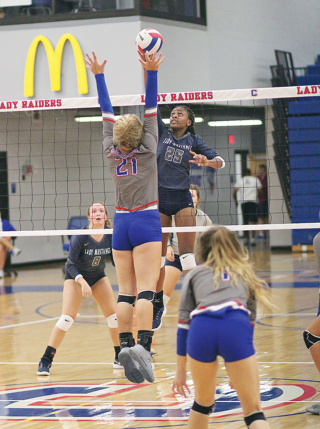 WALKER VALLEY middle hitter Jia Weathersby battles Cleveland's Jordan Whitcraft in game two of Tuesday's match between the Lady Raiders and Lady Mustangs, at Cleveland.