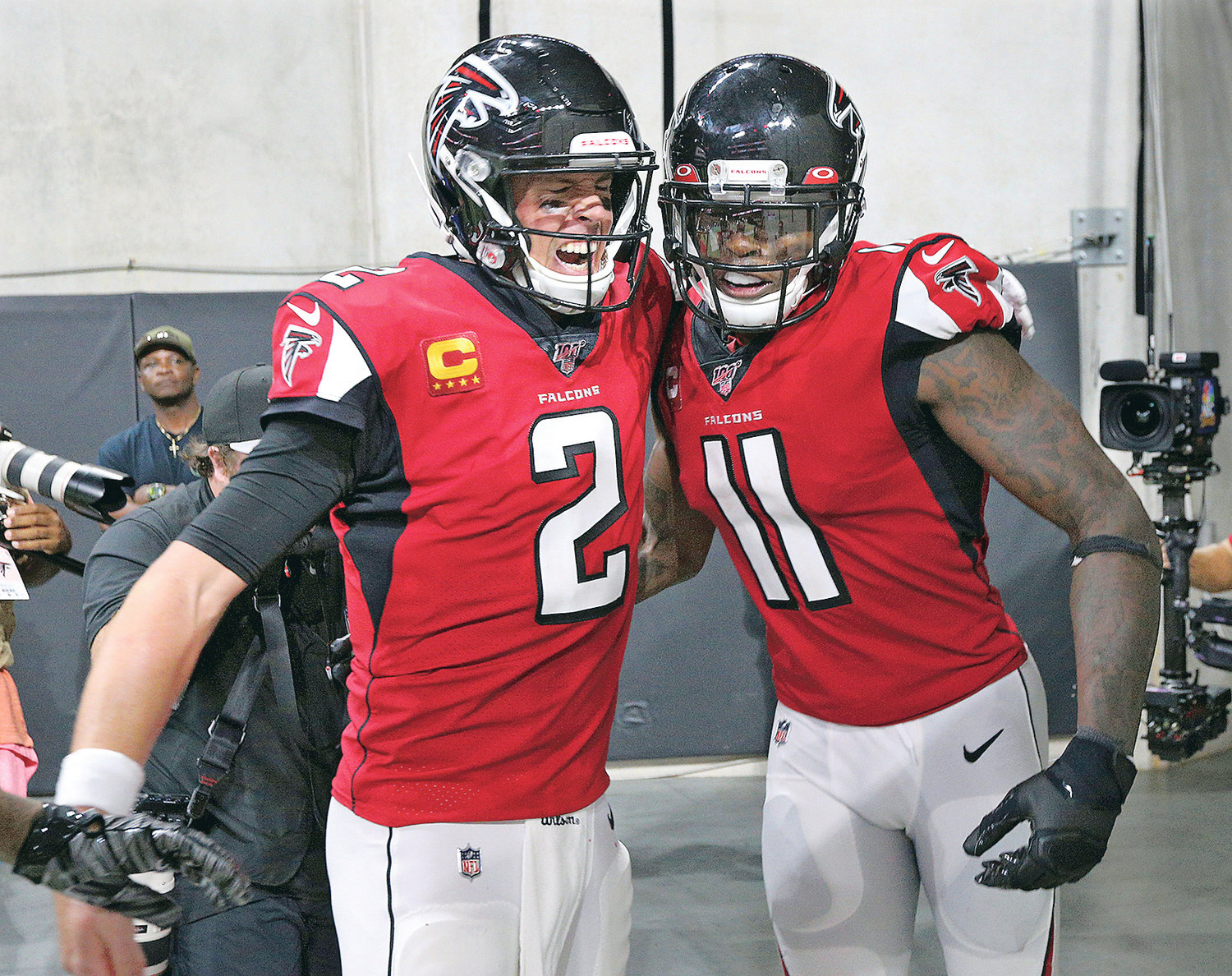 ATLANTA FALCONS quarterback Matt Ryan (2) celebrates with wide receiver Julio Jones (11) after his go-ahead touchdown reception against the Philadelphia Eagles Sunday, in Atlanta.