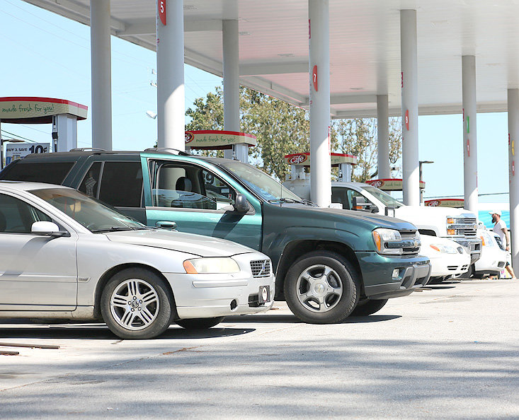 VEHICLES line up at the Speedway 25th Street Monday to take advantage of fuel prices before they were expected to rise due to an attack on oil production facilities in Saudi Arabia on Saturday.