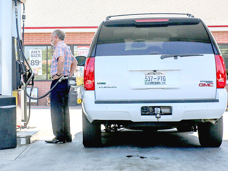 A CUSTOMER fills up his vehicle at a local gas station Monday afternoon in Cleveland, where some of the lowest prices per gallon in the state were available.