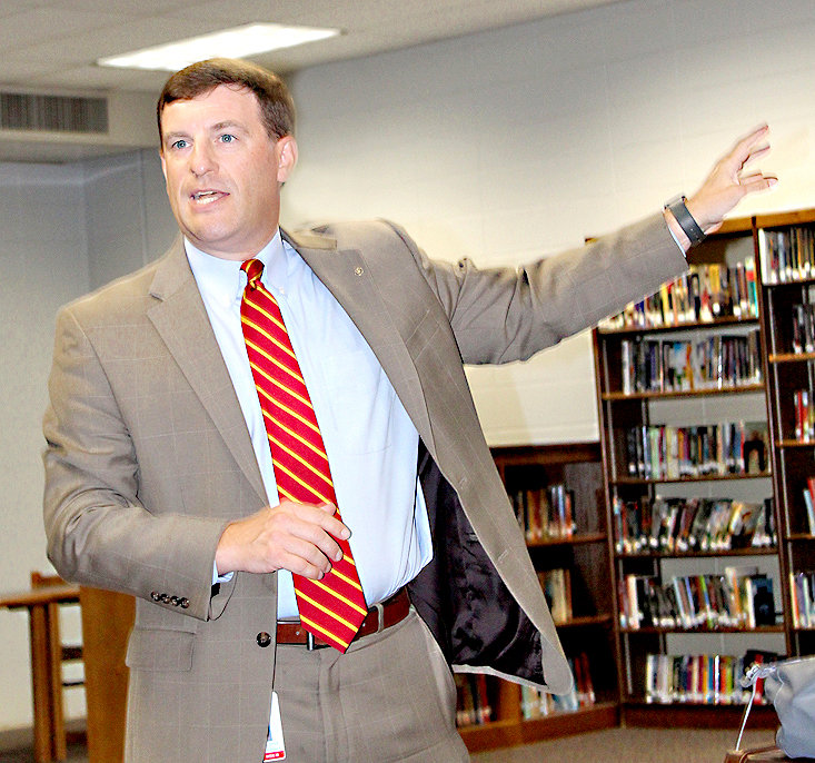 CLEVELAND DIRECTOR of Schools Dr. Russell Dyer gestures Thursday evening as he was explaining the importance of gathering information from parents for compiling a five-year plan for Cleveland City Schools.