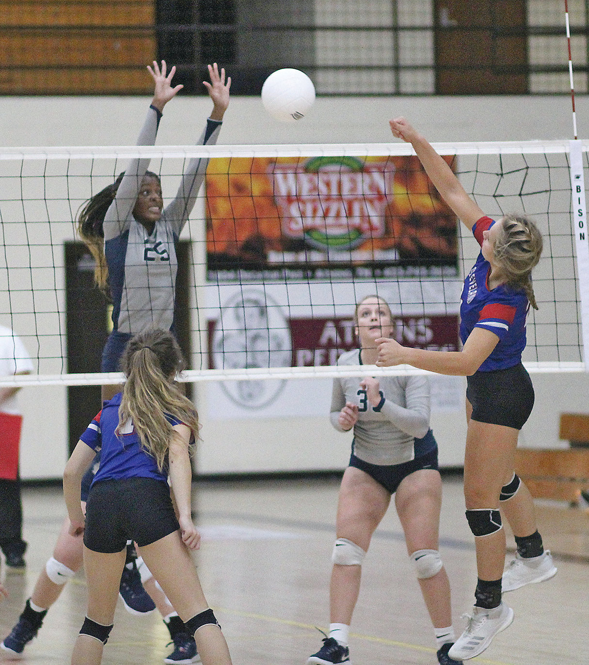 CLEVELAND'S JORDAN WHITCRAFT, right, battles Walker Valley's Jia Weathersby in the second set of the District 5-AAA volleyball championship Tuesday, in Athens.