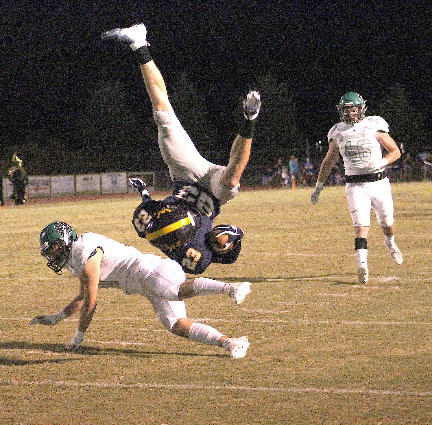 "WALKER VALLEY wide receiver Brody Swafford (23) is upended at the East Hamilton 1-yard line after an 18-yard completion on a pass from quarterback Tyler Pope in the second quarter Friday, inside ""The Corral."""