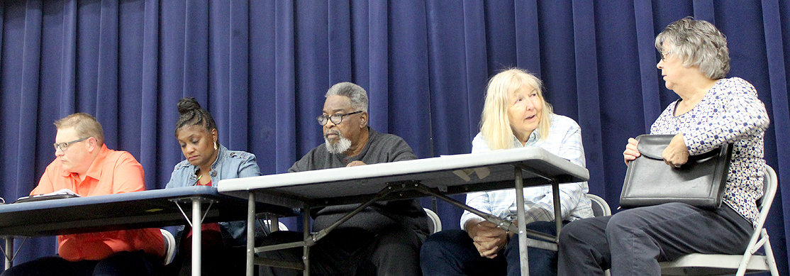 CHARLESTON CITY officials met with several neighbors Tuesday night to discuss the possible annexation of their respective neighborhoods. The officials include, from left, Commissioner Frankie McCartney, Commissioner Donna McDermott, Mayor Walter Goode, City Manager Caroline Geren and City Recorder Janet Newport.