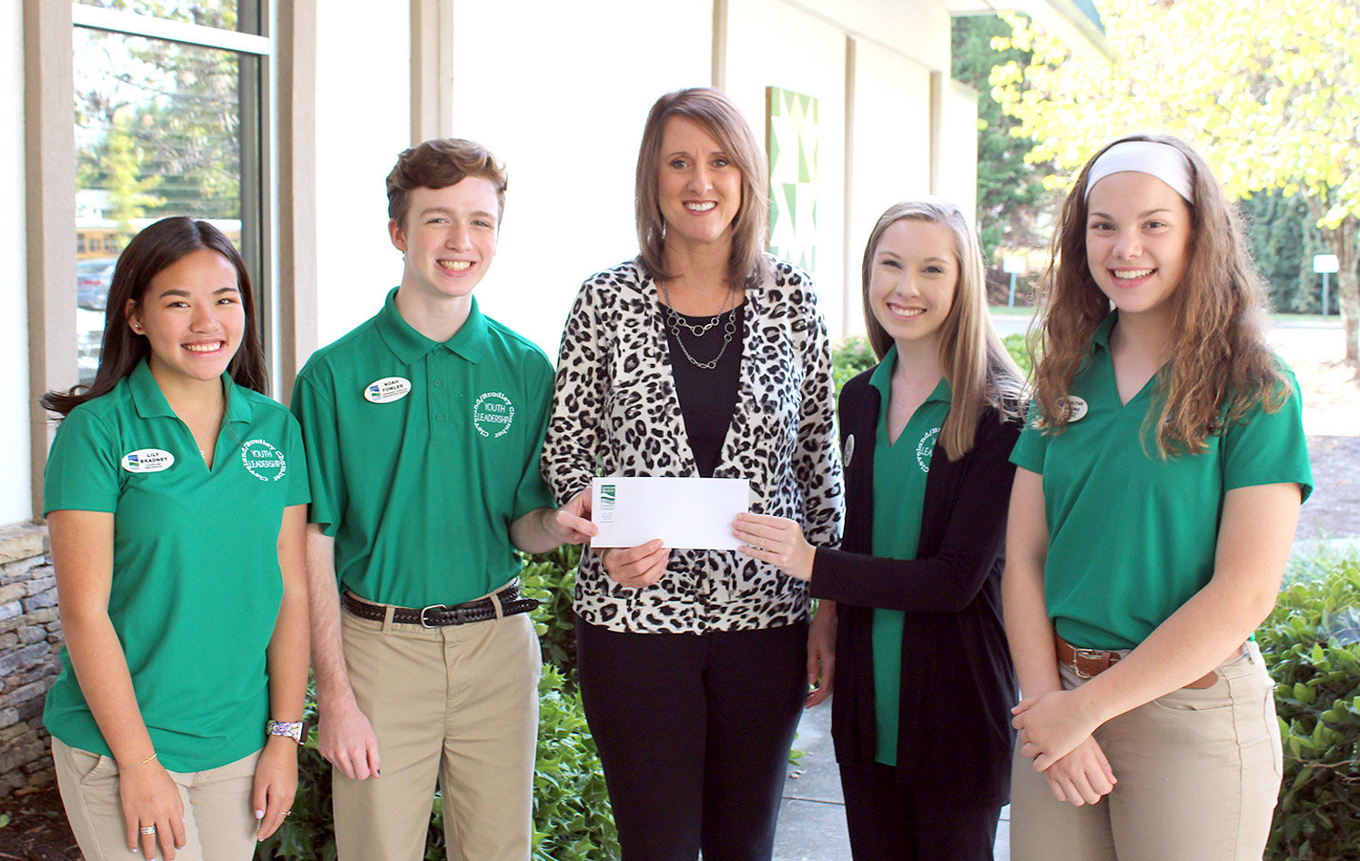 Student leaders present $1,687.78 to Tammy Johnson, Habitat for Humanity of Cleveland executive director, as part of their 2019-20 service project. Youth Leader student representatives shown, from left, are: Lily Bradney, Cleveland High School; Noah Fowler, Tennessee Christian Preparatory School; Erica Yates, Bradley Central High School; and Ashlynn Akiona, Walker Valley High School.
