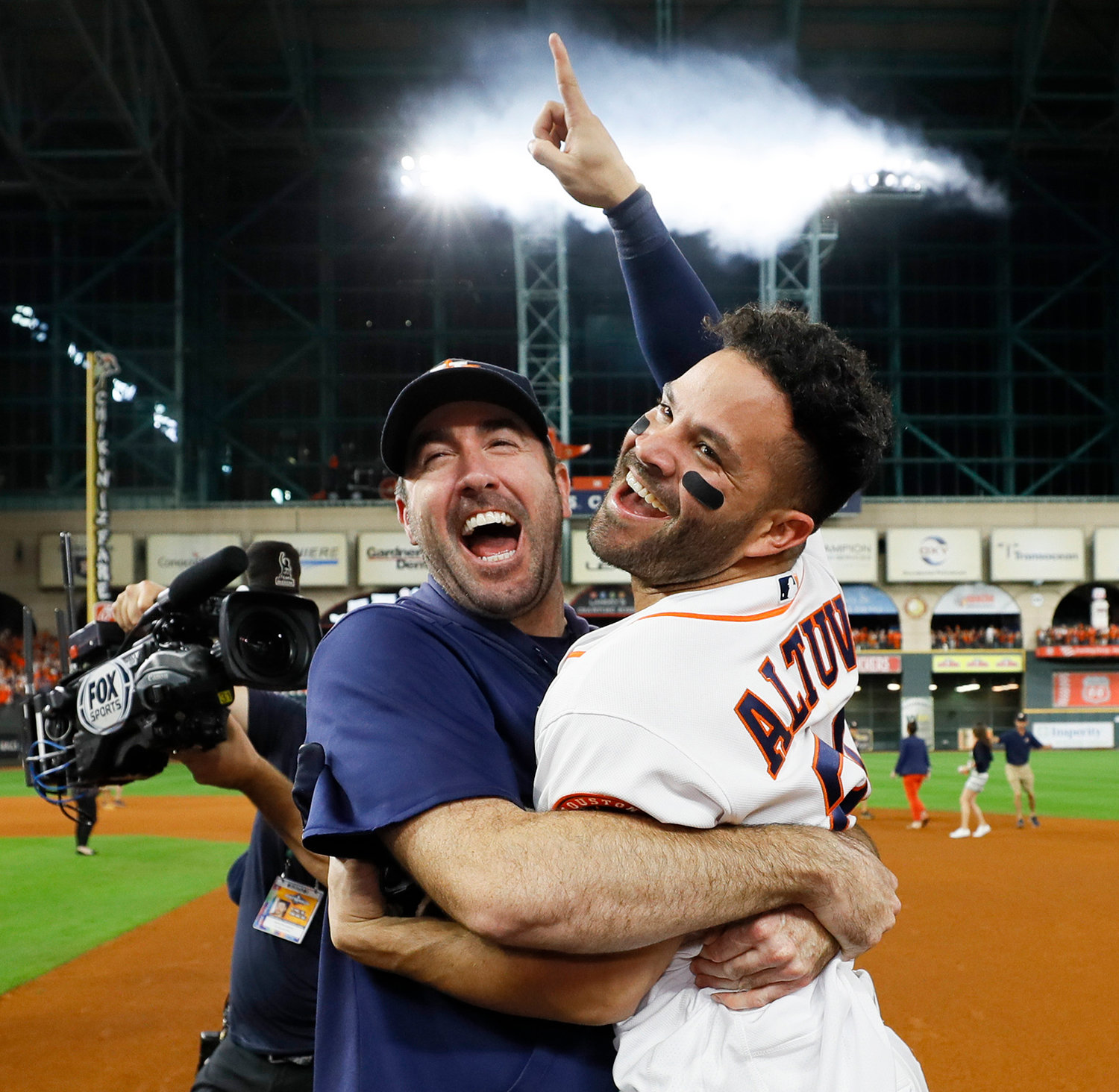 HOUSTON ASTROS Jose Altuve, right, and starting pitcher Justin Verlander celebrate after winning Game 6 of the MLB American League Championship Series against the New York Yankees Saturday in Houston. The Astros won 6-4 to win the series 4-2.
