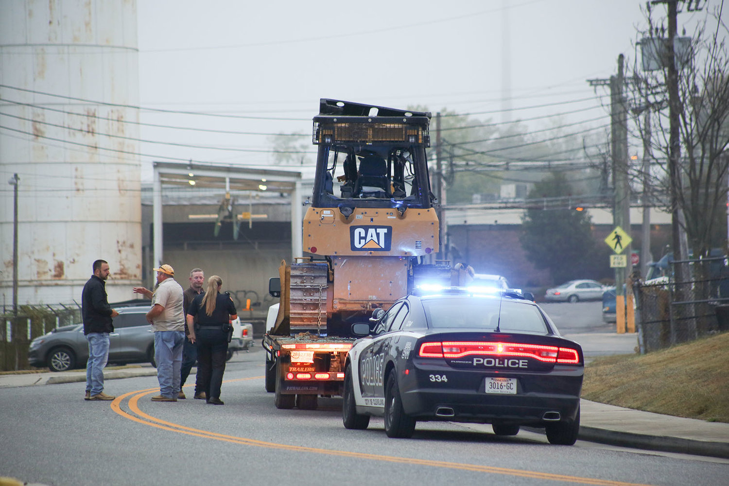 A BACKHOE hauled by a truck was damaged after crashing into the Inman Street railroad bridge/underpass Monday morning. The incident temporarily closed Inman Street during morning rush hour.