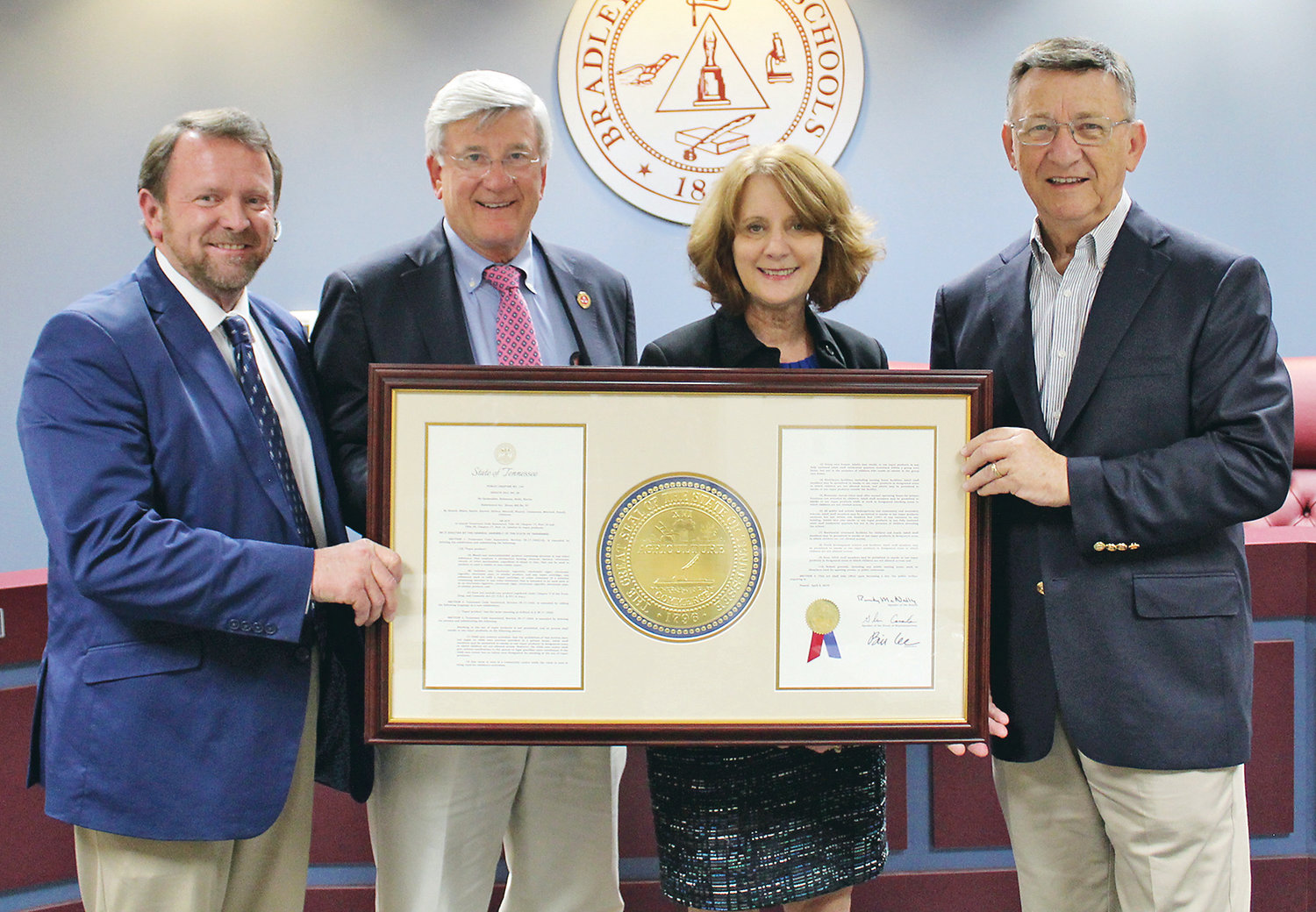 BRADLEY COUNTY SCHOOLS Director Dr. Linda Cash and Bradley County School Board Chairman Troy Weathers, far left, stand with state Sen. Todd Gardenhire, second from left, and state Rep. Dan Howell, fourth from left, after they were presented with a framed text of a vaping bill signed by Tennessee Gov. Bill Lee last month.