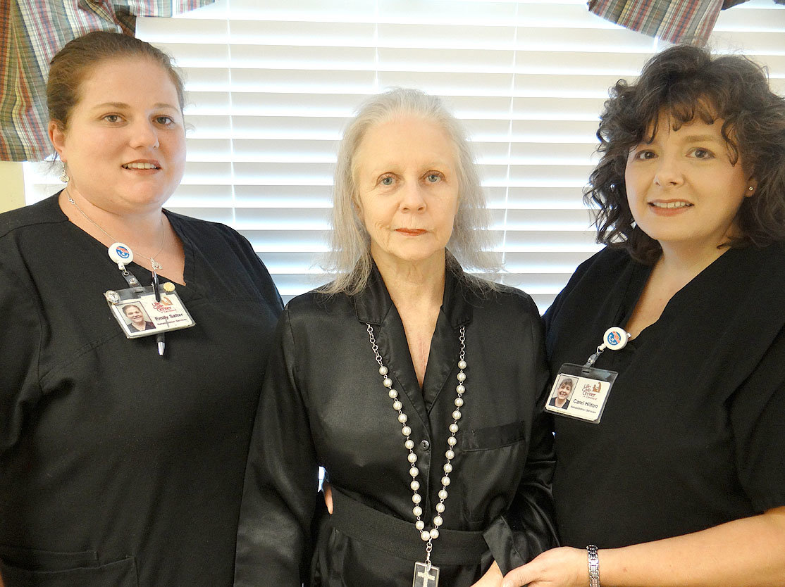 From left are Emily Salter, occupational therapist assistant; Darlene Mullins; and Camila Hilton, physical therapist assistant.