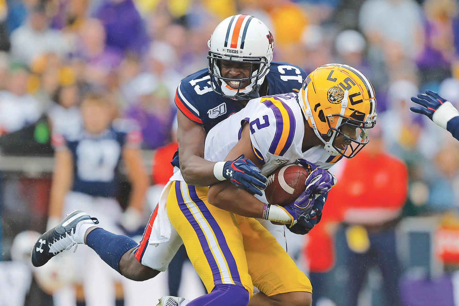 AUBURN DEFENSIVE BACK Javaris Davis (13) tackles LSU wide receiver Justin Jefferson (2) in the first half, in Baton Rouge, La.
