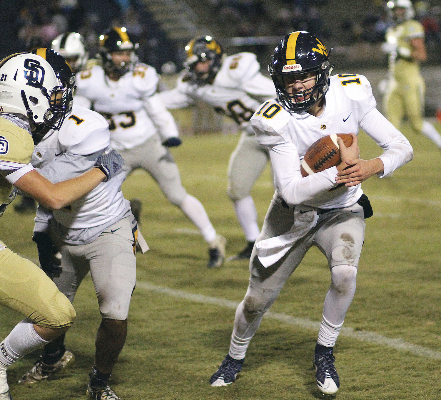 WALKER VALLEY quarterback Tyler Pope (10) looks to evade a tackle by a Soddy-Daisy defender. Pope will lead the Mustangs Friday night as they face Knoxville West in the first round of the TSSAA football playoffs.