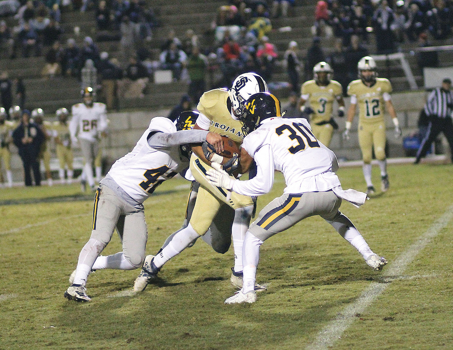 WALKER VALLEY MUSTANGS Reid Gibson (30) and Eli Denton (42) bring down a Soddy-Daisy runner. The Mustangs face Knox West in the opening round of the TSSAA football playoffs Friday, in Knoxville.