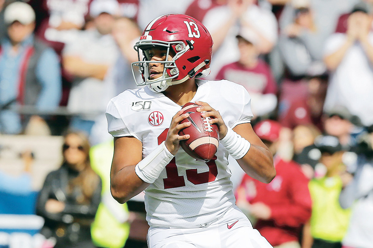 ALABAMA QUARTERBACK Tua Tagovailoa (13) looks to pass against Texas A&M, during the first half of an NCAA college football game, Saturday, Oct. 12, 2019, in College Station, Texas.