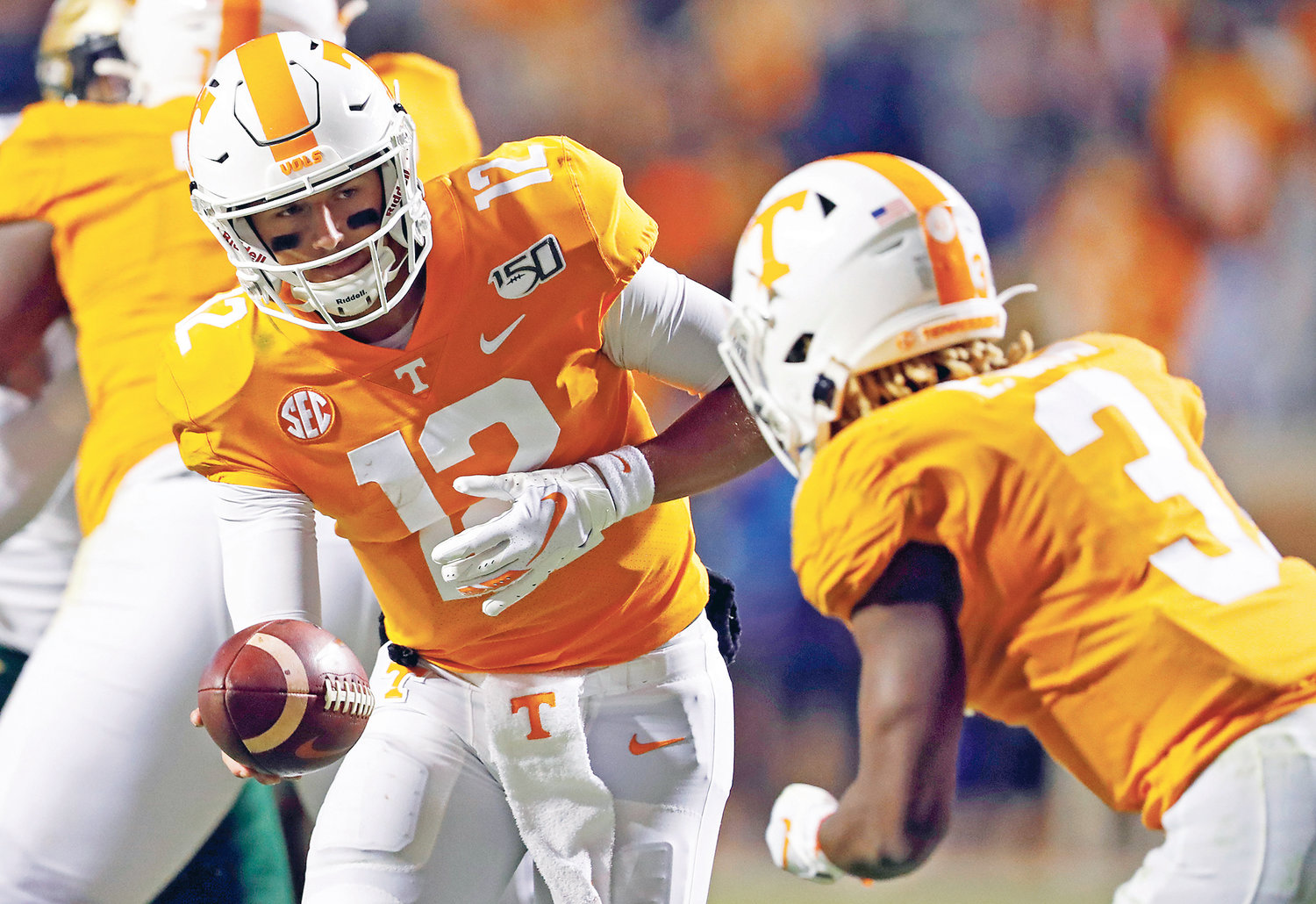 TENNESSEE VOLUNTEERS quarterback J.T. Shrout (12) hands the ball off to running back Eric Gray (3) in the second half, in Knoxville.