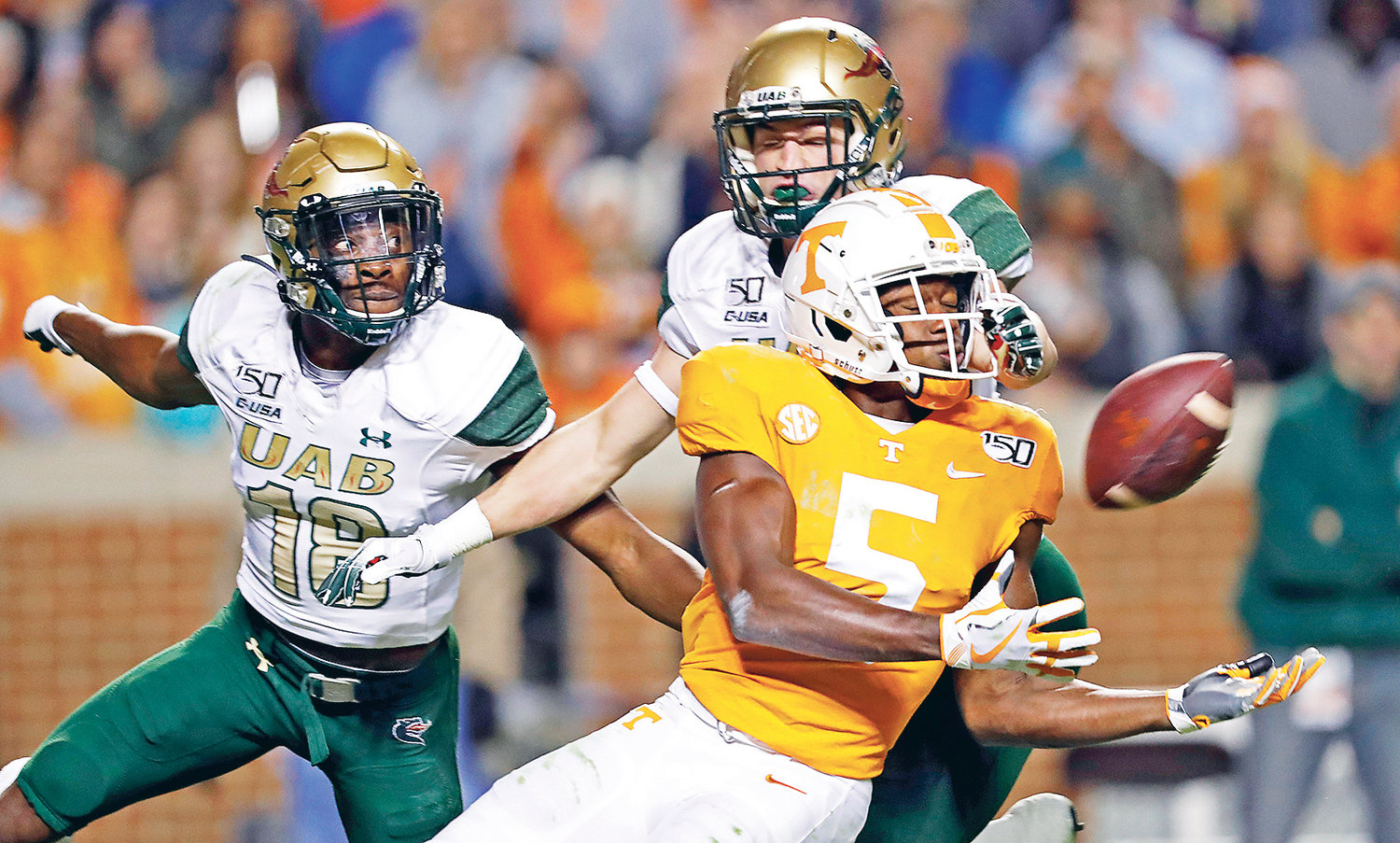 TENNESSEE WIDE RECEIVER Josh Palmer (5) tries to make a catch as he's defended by UAB's TD Marshall (18) in the second half, in Knoxville.