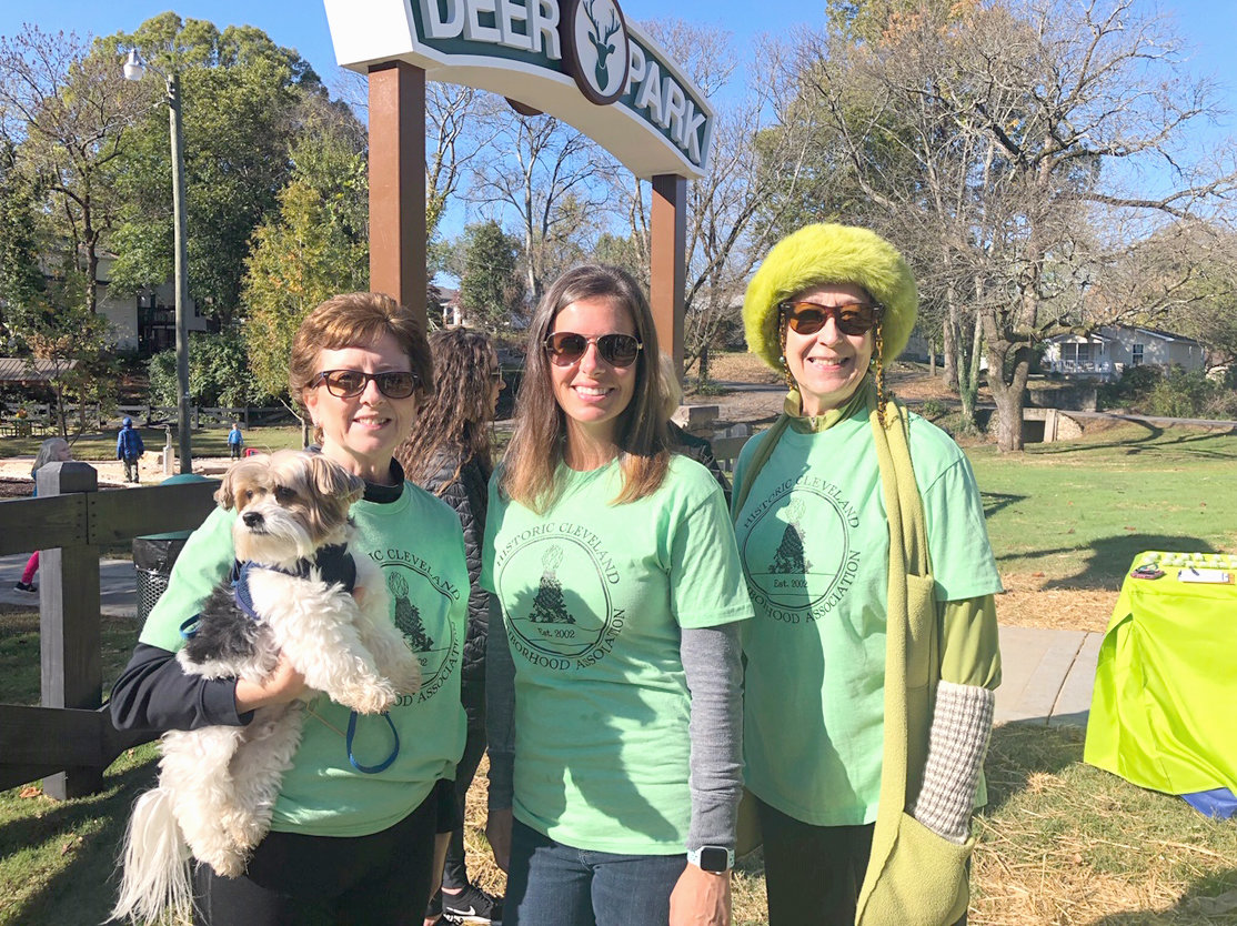 Among the Historic Cleveland Neighborhood Association members attending the Deer Park reopening were, from left, Kim Griffin, Charlie the dog, Amanda Madson and Jane Easterly.