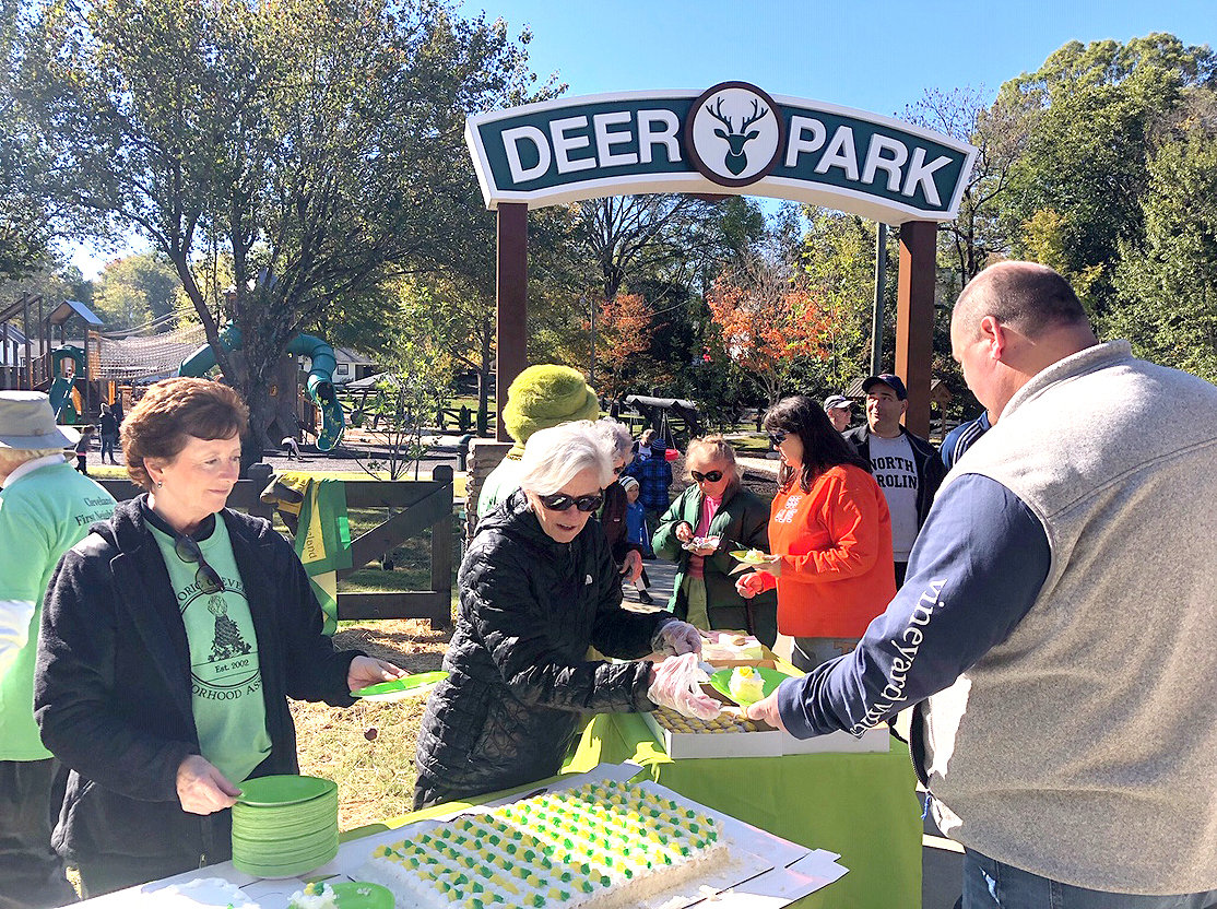 Kim Griffin and Judy Chandler serve cake to attendees at the recent Deer Park reopening.