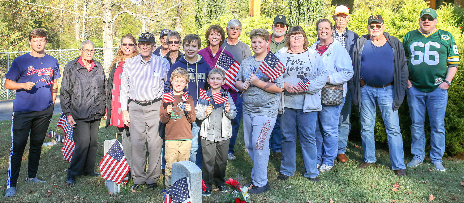 THE GROUP OF VOLUNTEERS who placed flags at the Bradley County Veterans Cemetery in honor of veterans included nearly 20 people. Historically, the flags are distributed on Veterans Day, Memorial Day and the Fourth of July for at least the past 10 years by AmVets and volunteers.