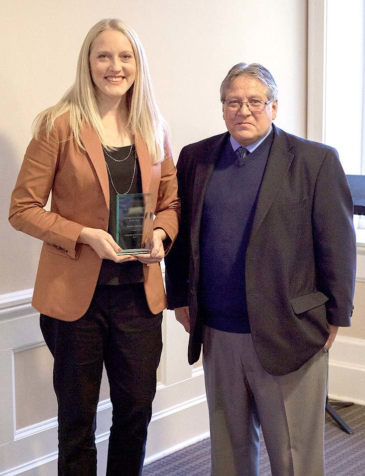 Jessica Hanson and Dr. José Minay pose following the award presentation of Department of Language and Literature Alumna of the Year.